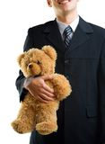Young man with teddy bear Royalty Free Stock Image