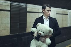 Young man with a teddy bear. Young man with a teddy bear, he worries before the meeting Stock Photo
