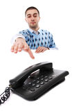 Young man and telephone Stock Image
