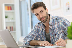Young man teleworking and taking notes Royalty Free Stock Photography