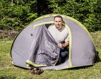 Young man in a tent Royalty Free Stock Image