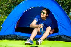 Young Man in the Tent stock photos