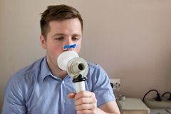 Young man testing breathing function by spirometry. Take care about health royalty free stock photos