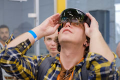 Young man testing hololens VR glasses at VR conference Stock Images