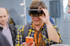 Young man testing hololens VR glasses at VR conference Royalty Free Stock Image