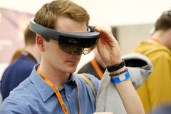 Young man testing hololens VR glasses at VR conference Stock Photography