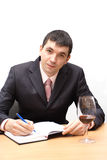 Young man testing a wine. Young man with wineglass tasting a red wine Stock Images