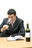 Young man testing a wine. Young man with wineglass tasting a red wine Stock Photography
