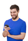 Young man text messaging on cell phone. Royalty Free Stock Photos