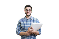 Young man with textbook. Handsome bearded young man in glasses hold textbook Stock Image