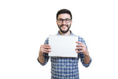Young man with textbook. Handsome bearded young man in glasses hold textbook with copy space Stock Photography