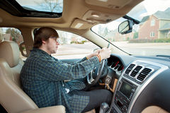 Young man texting and driving Royalty Free Stock Photo