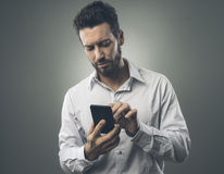 Young man texting with mobile Royalty Free Stock Photography