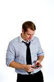 Young Man Texting with Smart Phone. Portrait of a content young man texting on a smart phone. Isolated on white Royalty Free Stock Photos