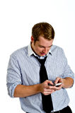 Young Man Texting with Smart Phone Stock Image