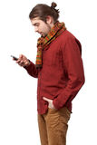 Young man texting sms Royalty Free Stock Photography
