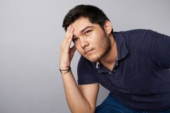 Young man think on problem. Theme. Teenager problems royalty free stock photo