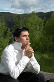 Young man thinking. Outdoors Royalty Free Stock Image