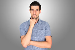 Young man thinking. Attractive casual young man thinking or concentrating Royalty Free Stock Photo