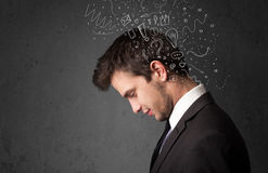 Young man thinking with abstract lines and symbols Stock Image