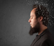 Young man thinking with abstract lines and symbols Royalty Free Stock Images