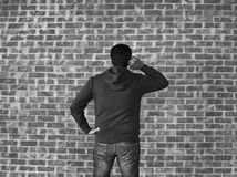 Young man thinking against wall ,black and white Stock Photo
