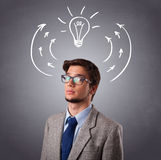 Young man thinking with arrows and light bulb overhead Stock Photos
