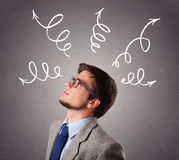 Young man thinking with arrows overhead Stock Images