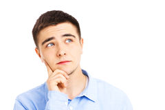 Young man thinking Stock Images