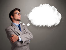 Young man thinking about cloud speech or thought bubble with cop Stock Images