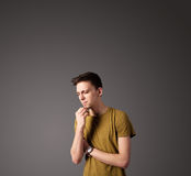 Young man thinking with copy space Stock Photography