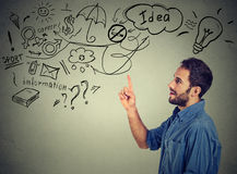 Young man thinking dreaming has many ideas looking up Stock Photo