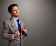 Young man thinking with empty copy space Stock Images