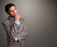 Young man thinking with empty copy space Stock Image