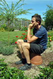 Young man thinking in the garden Royalty Free Stock Photo