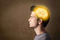 Young man thinking with glowing brain illustration Stock Photography