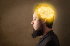 Young man thinking with glowing brain illustration Stock Images