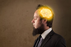 Young man thinking with glowing brain illustration Royalty Free Stock Photography