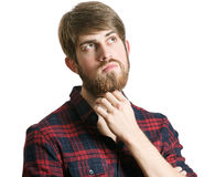 Young man thinking. Handsome bearded young man thinking about something isolated on a white background Royalty Free Stock Photo
