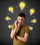 Young man thinking with lightbulb circulation around his head Stock Photos