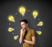 Young man thinking with lightbulb circulation around his head Royalty Free Stock Photos