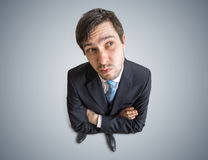 Young man is thinking and looking at you. View from above Royalty Free Stock Photography