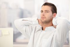 Young man thinking in office Royalty Free Stock Images