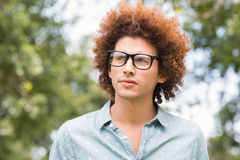 Young man thinking in the park Stock Image