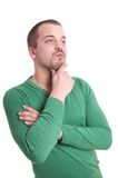 Young man thinking. Pensive young man with goatee beard Royalty Free Stock Images