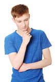 Young man thinking about a problem Stock Photography