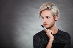 Young man thinking seek a solution Royalty Free Stock Photography