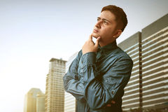 Young man thinking. Of something Royalty Free Stock Photos