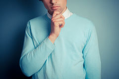 Young man is thinking Royalty Free Stock Image