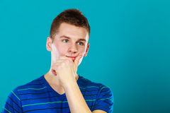 Young man thinking, thoughtful face expression Royalty Free Stock Images
